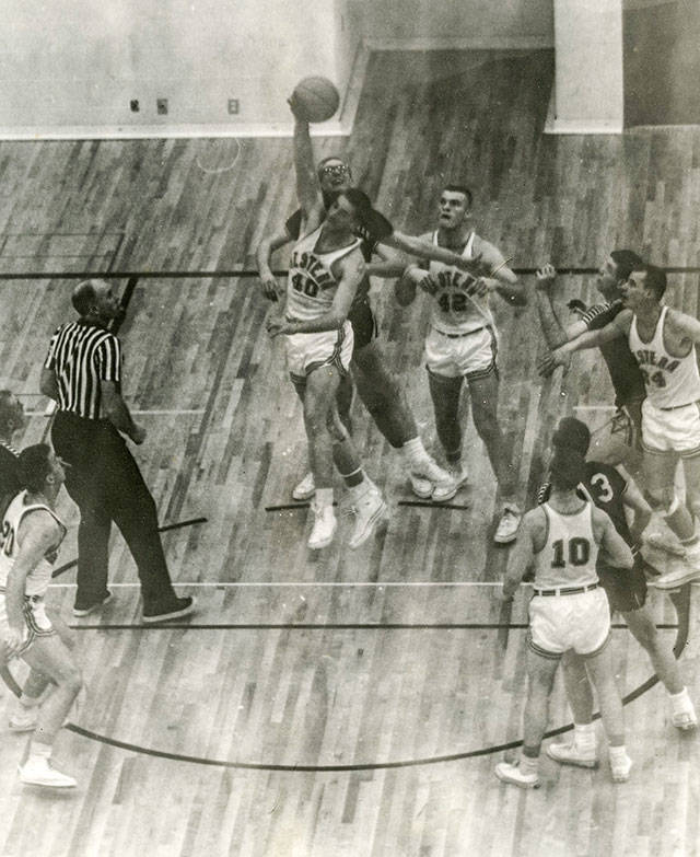 Jim Adams (40) reaches up to tip a jump ball during a game for Western Washington University. Adams was inducted into the Western Washington University Hall of Fame in 1983. (Contributed photo)