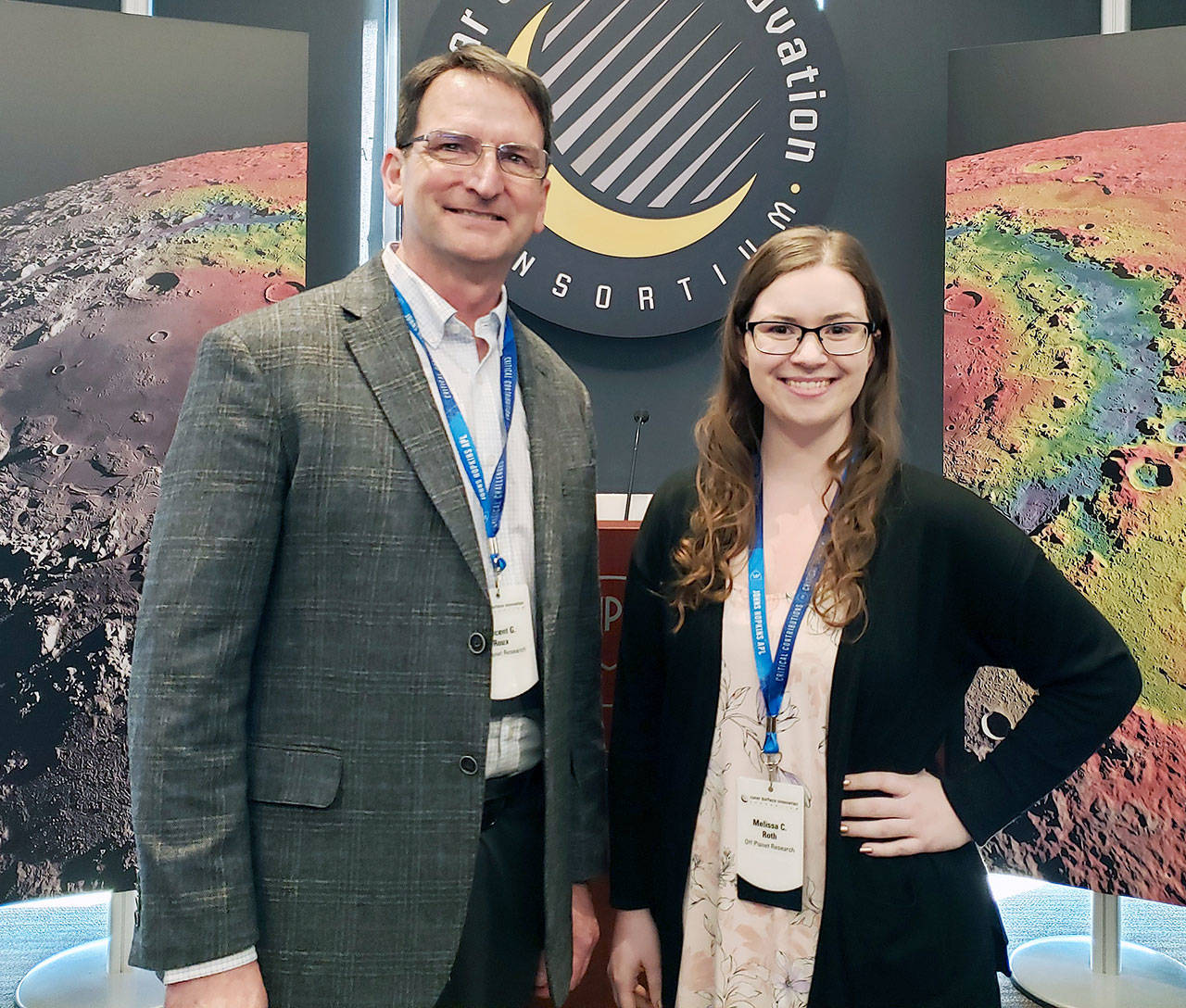 Vince Roux (left) and Melissa Roth, founders of Off Planet Research, at the Lunar Surface Innovation Consortium Conference in February 2020. The company makes lunar soil simulants for researchers. (Off Planet Research)