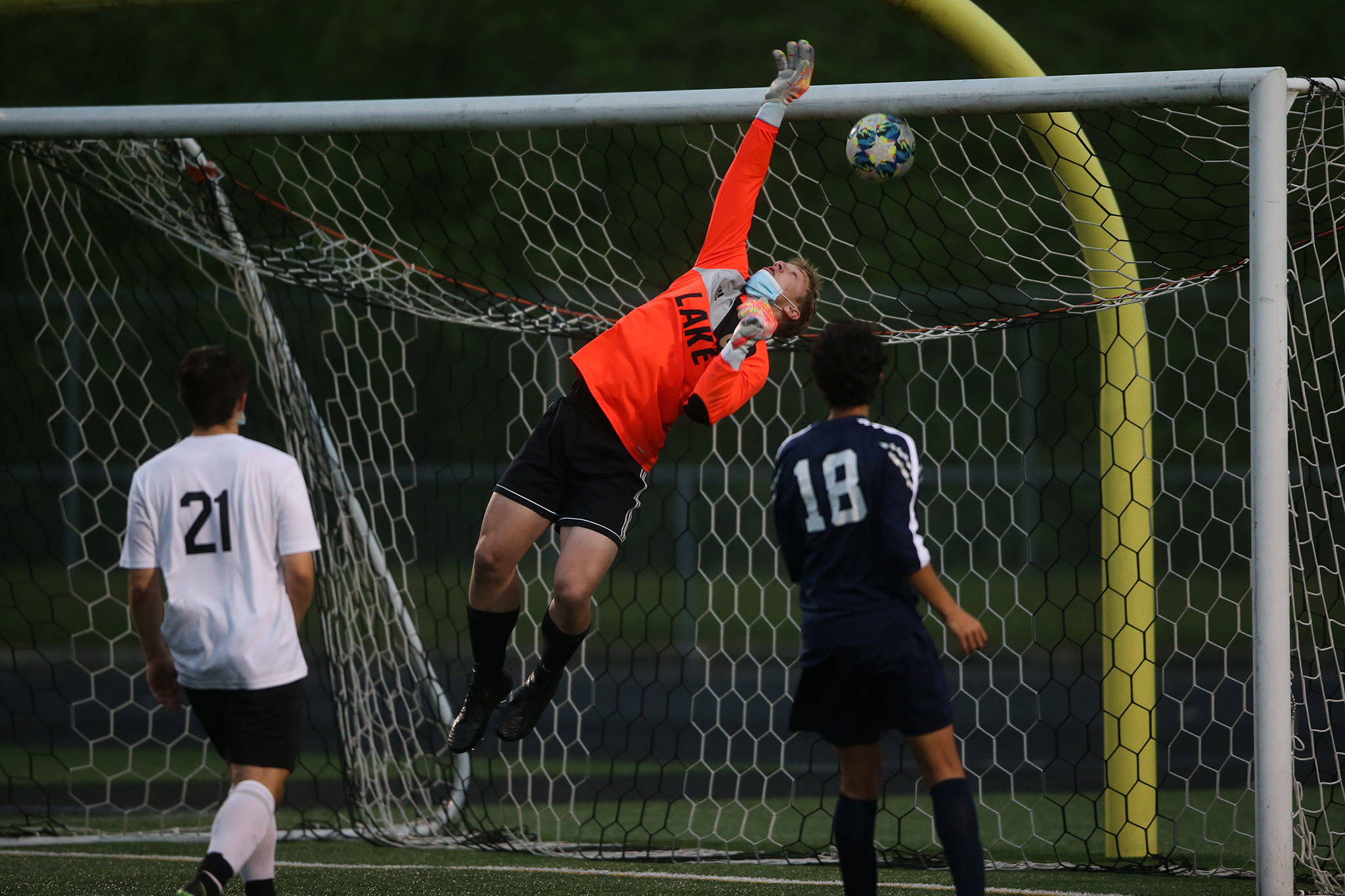 Lake Stevens' Tanner Jordan leaps but misses the ball for an Arlington goal as Arlington beat Lakes Stevens 2-1 in a boys soccer match on Monday, May 3, 2021 in Arlington, Washington. (Andy Bronson / The Herald)