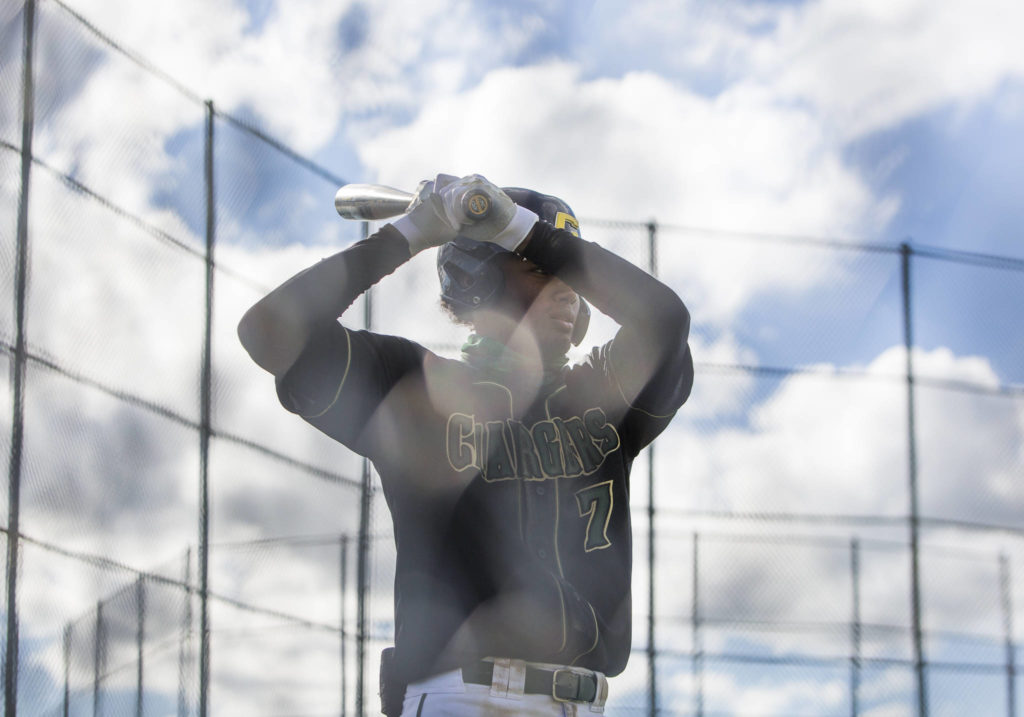 Marysville Getchell's Malakhi Knight warms up before batting during a game against Arlington on May 7, 2021, in Arlington. (Olivia Vanni / The Herald)
