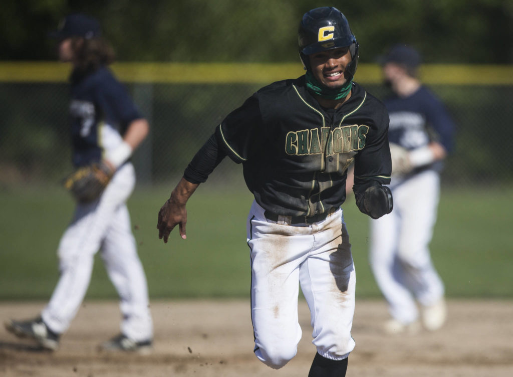 Marysville Getchell's Malakhi Knight runs to third base for a steal during the game against Arlington on Friday, May 7, 2021 in Arlington, Wash. (Olivia Vanni / The Herald)