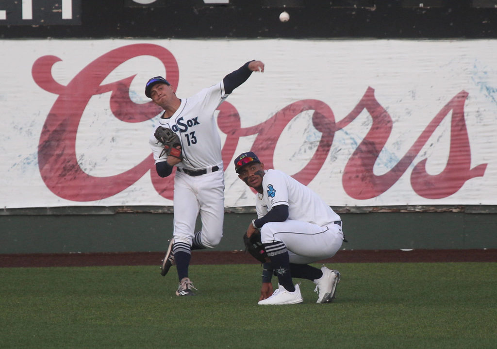 The AquaSox's Jack Larsen throws the ball over teammate Julio Rodriguez during a game against the Dust Devils on May 11, 2021, at Funko Field in Everett. (Andy Bronson / The Herald)