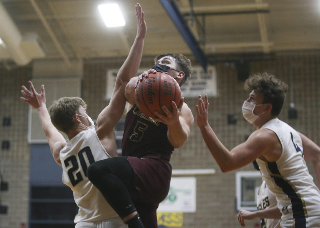 Lakewood's Justice Taylor gets past the Arlington defense for a basket during a game on May 19, 2021, in Arlington. (Andy Bronson / The Herald)