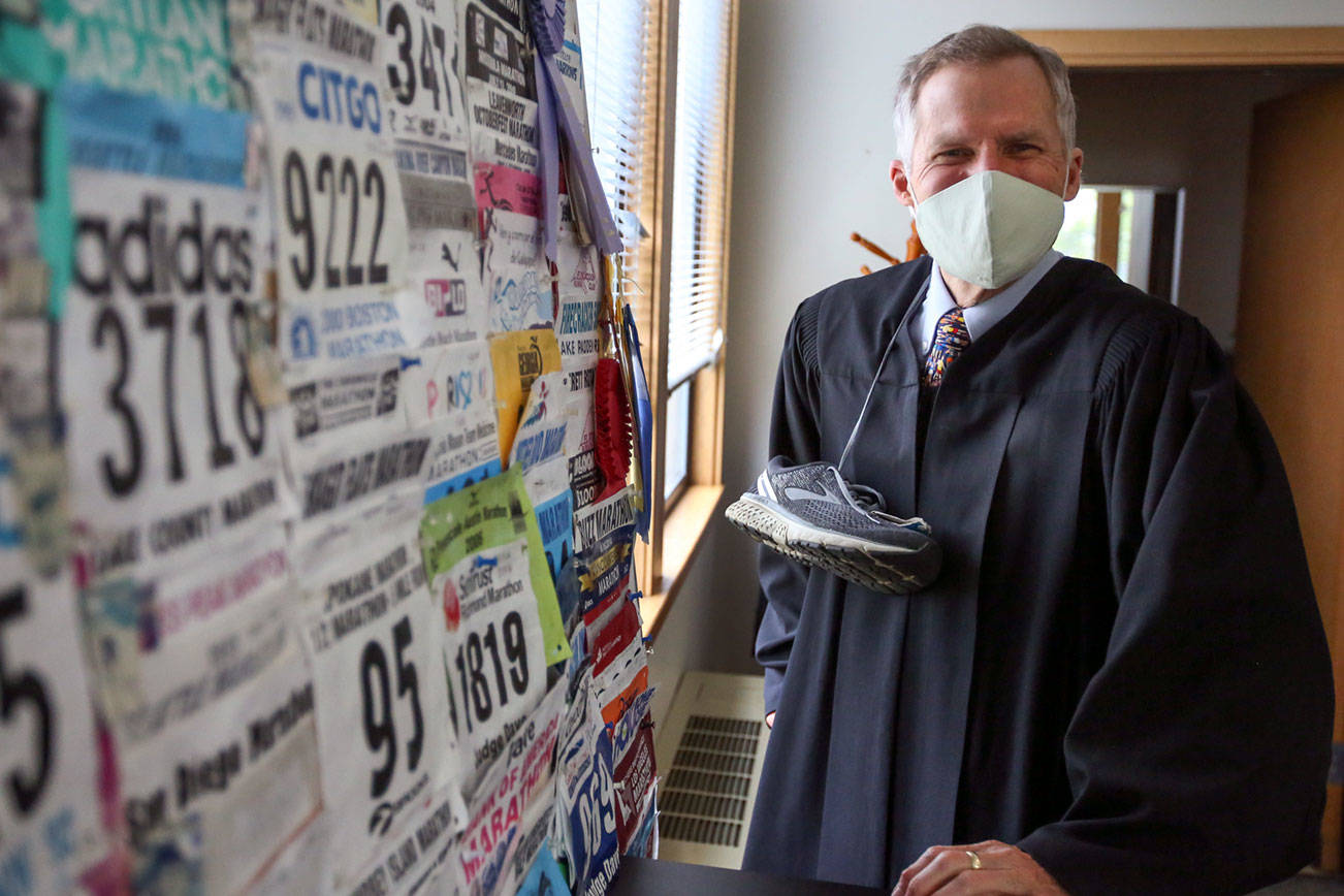 Judge David Kurtz of the Snohomish County Superior Court is retiring from the bench. He has run more than 90 marathons and among his favorite roles has been presiding over adoptions during National Adoption Day.  (Kevin Clark / The Herald)
