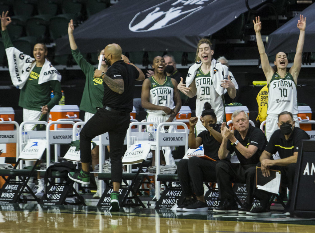 The Seattle Storm bench reacts to a three-point shot during the game against Minnesota on Friday, May 28, 2021 in Everett, Wash. (Olivia Vanni / The Herald)