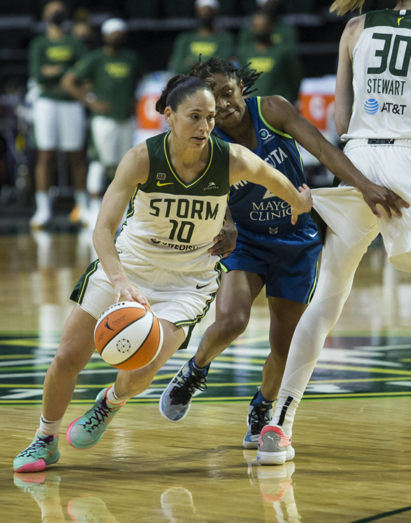 Seattle Storm's Sue Bird maneuvers around a screen by Breanna Stewart during the game against Minnesota on Friday, May 28, 2021 in Everett, Wash. (Olivia Vanni / The Herald)