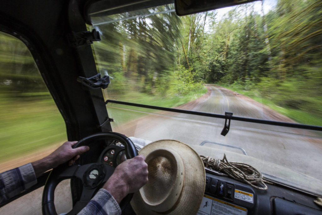 Bruce Kimball drives along an empty Index-Galena Road on May 9 in Index. (Olivia Vanni / The Herald)