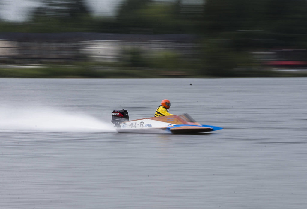 Mitchell Sampson races around the first turn of the course during the Silver Lake Regatta on Saturday, June 5, 2021 in Everett, Wash. (Olivia Vanni / The Herald)
