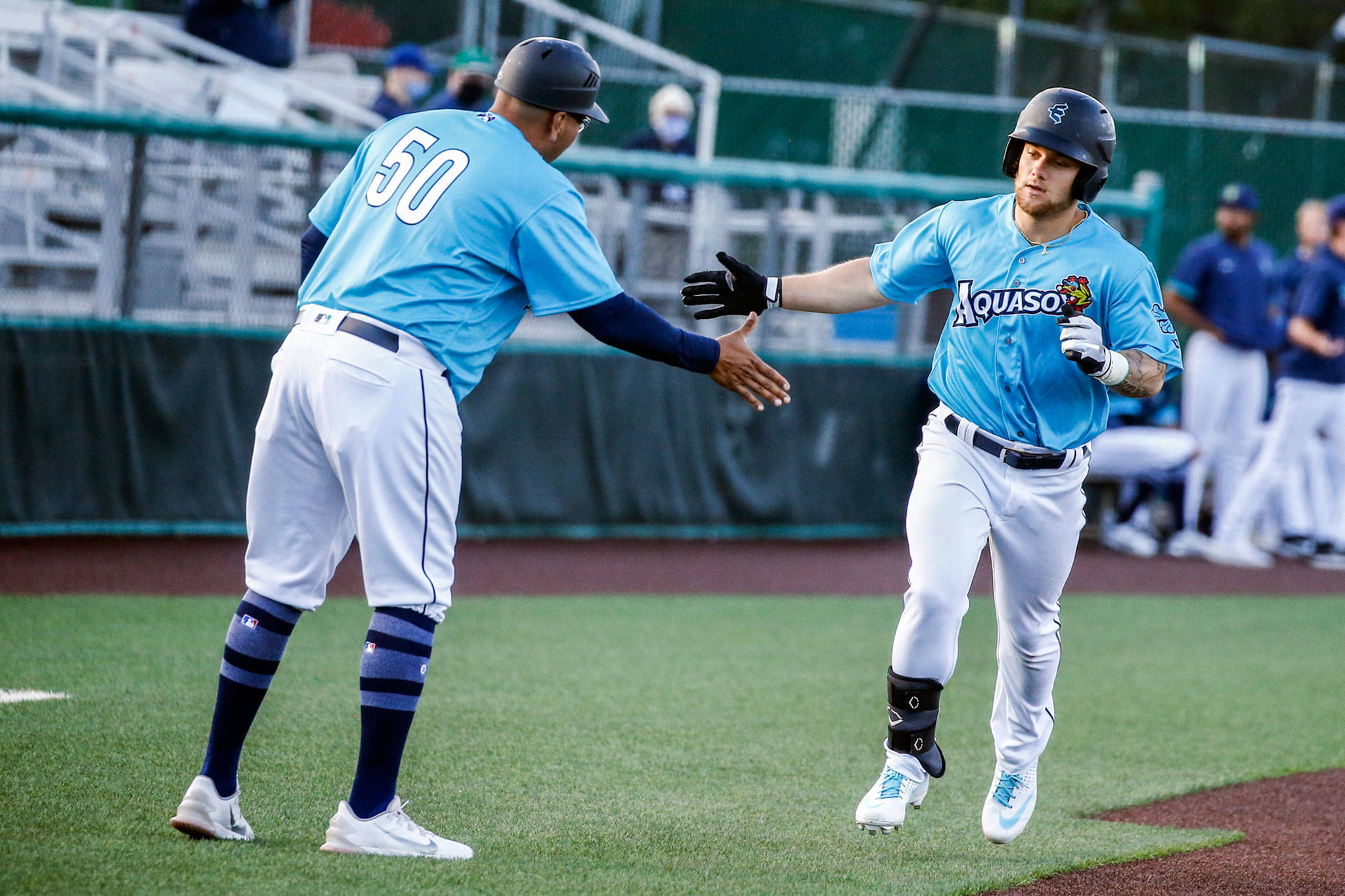 Kaden Polcovich celebrates while rounding the bases after one of his five home runs this past week. (Kevin Clark / The Herald)