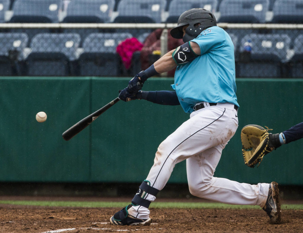 Carter Bins hits a home run during Sunday's game. (Olivia Vanni / The Herald)