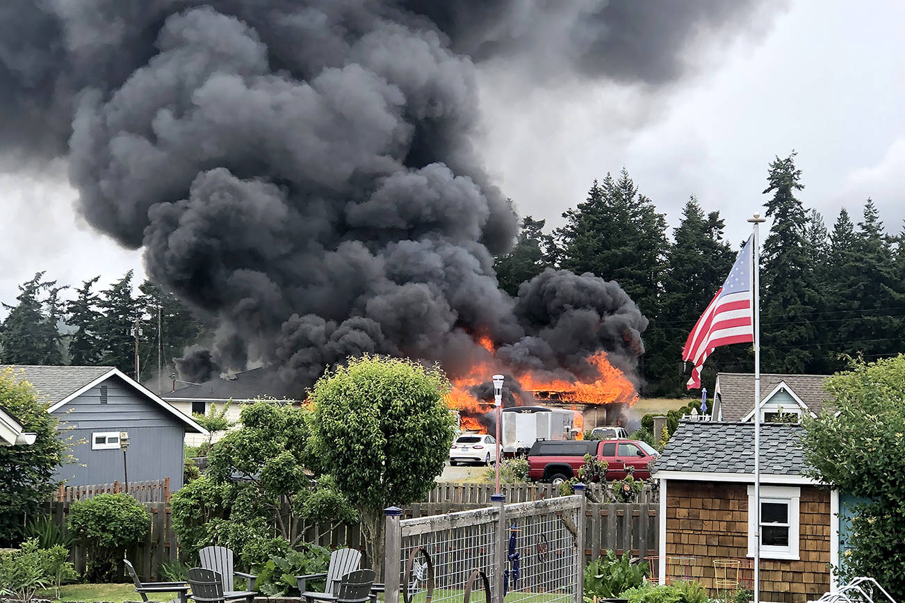 Thick plumes of smoke rose from a house fire Sunday afternoon in the 2000 block of Homestead Avenue in Clinton. (Gregory Doering)