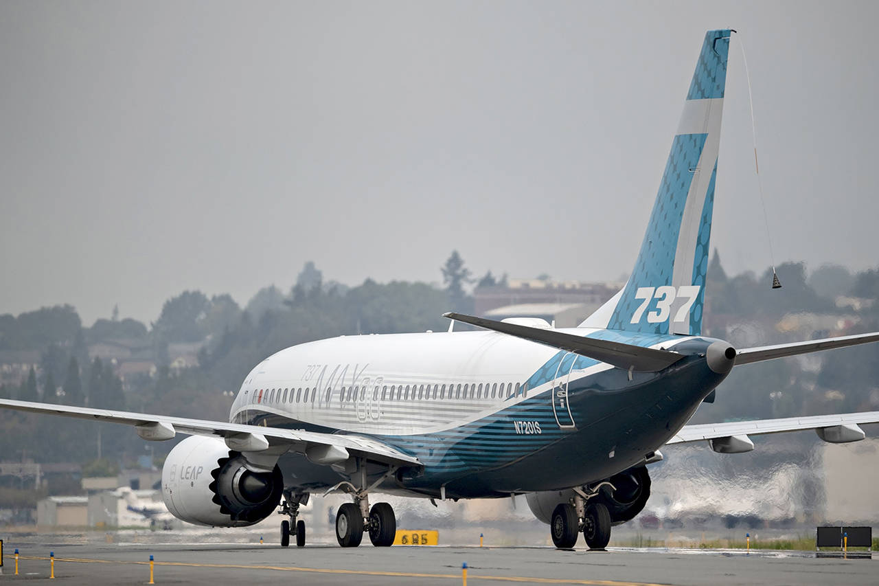 A Boeing 737 Max taxis after landing during a test flight in Seattle on Sept. 30, 2020. (Chona Kasinger/Bloomberg)