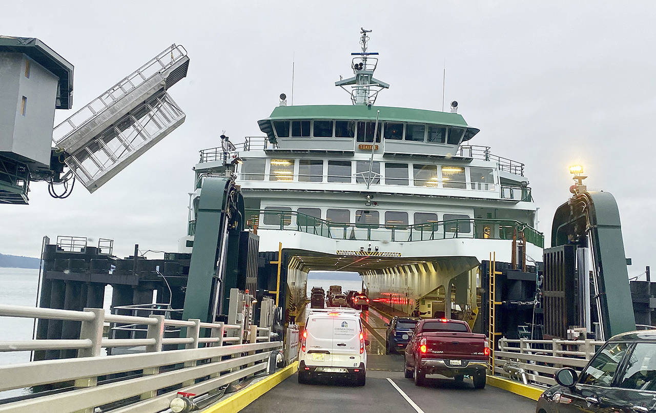 Passengers embark on the Tokitae ferry at the Mukilteo terminal in February. (Andrea Brown / Herald file)