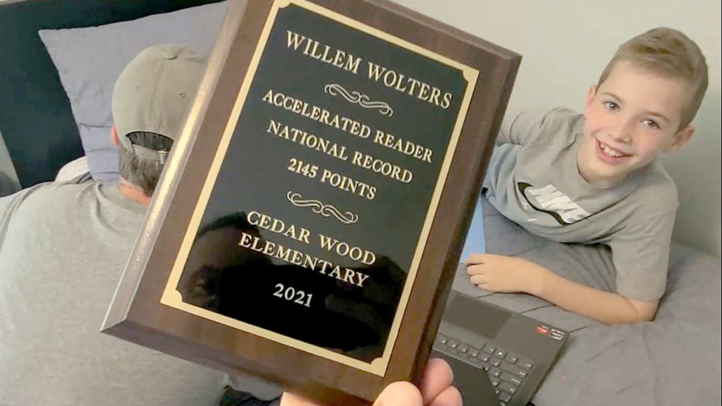 Willem Wolters' National Accelerated Reader Award will be displayed at the Cedar Wood Elementary School's library, from which many of the 380 books he read this school year were loaned. (Mark Smith)