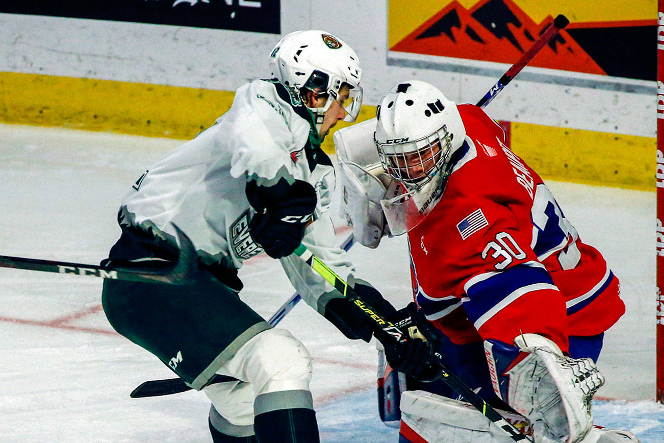 Silvertips' Cole Fonstad attempts a shot with Chiefs' Mason Beaupit defending during the final home game Friday night at Angel of the Winds Arena in Everett on May 7, 2021.  (Kevin Clark / The Herald)