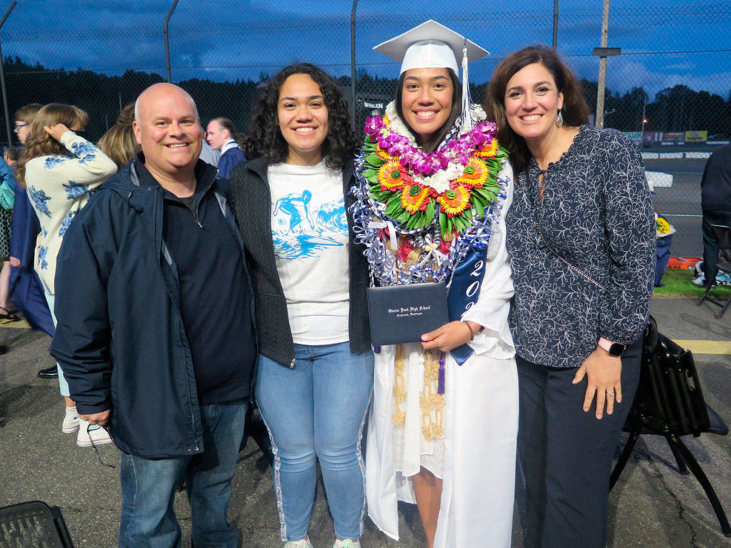 Glacier Peak High School class of 2021 graduate Naomi Fifita, seen here surrounded by her family at commencement at the Evergreen Speedway in Monroe, received one of 173 Snohomish Education Foundation's scholarships. (Snohomish Education Foundation)