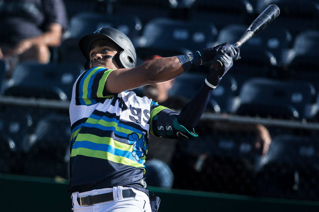 AquaSox's Julio Rodriguez watches the ball after hitting his fifth home run in six games on Sunday, May 16, 2021 in Everett, Wash.