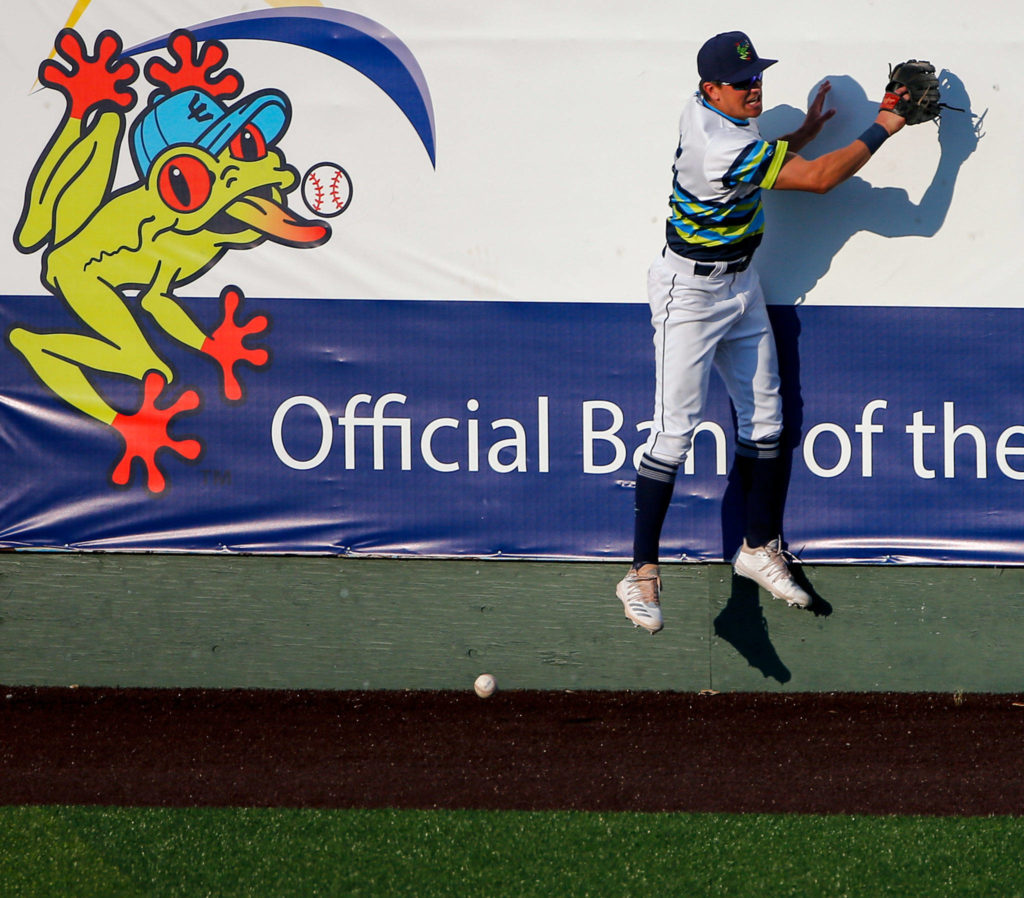 The AquaSox's Jack Larsen can't field a hit by a Canadians better during a game Tuesday evening at Funko Field in Everett. (Kevin Clark / The Herald)