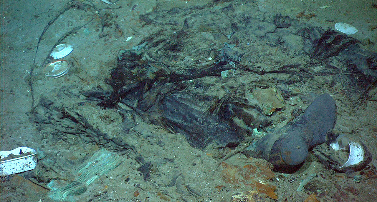 This 2004 photo shows the remains of a coat and boots in the mud on the sea bed near the Titanic's stern. The 109-year-old wreck is being battered by deep-sea currents and metal-eating bacteria. (Institute for Exploration, Center for Archaeological Oceanography/University of Rhode Island/NOAA Office of Ocean Exploration)