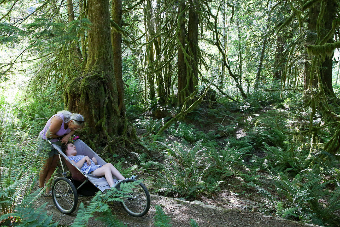 Karen Sample with her daughter Erin take in the view on the Erinswood Trail. The 0.6-mile loop is an ADA-accessible companion trail to the Leovy Trail in Index on July 6, 2021.  (Kevin Clark / The Herald)