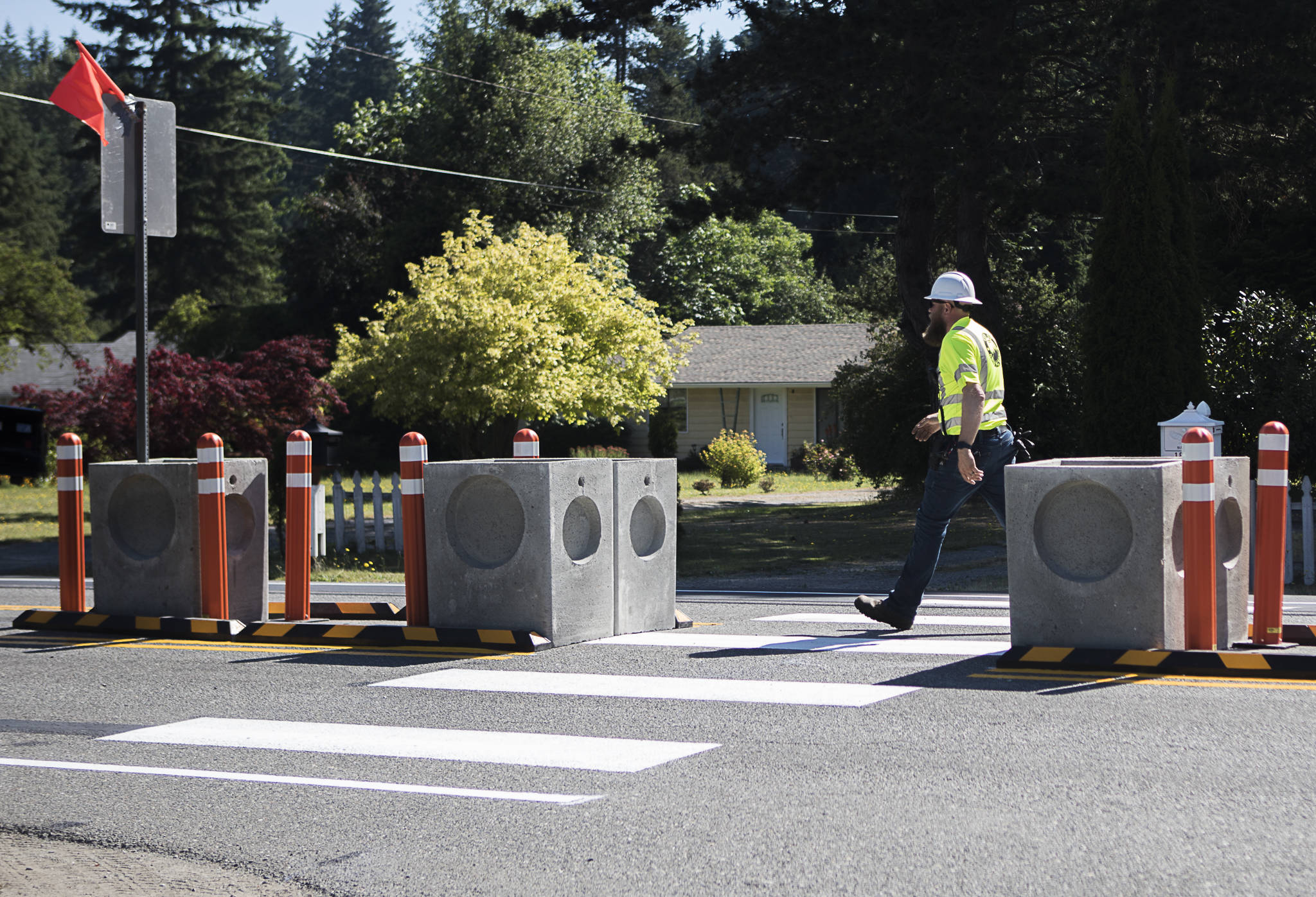 """A crosswalk at the intersection of 180th Street NE and Smokey Point Boulevard was installed June 27 as part of a """"complete streets"""" demonstration in Arlington. (Olivia Vanni / The Herald)"""