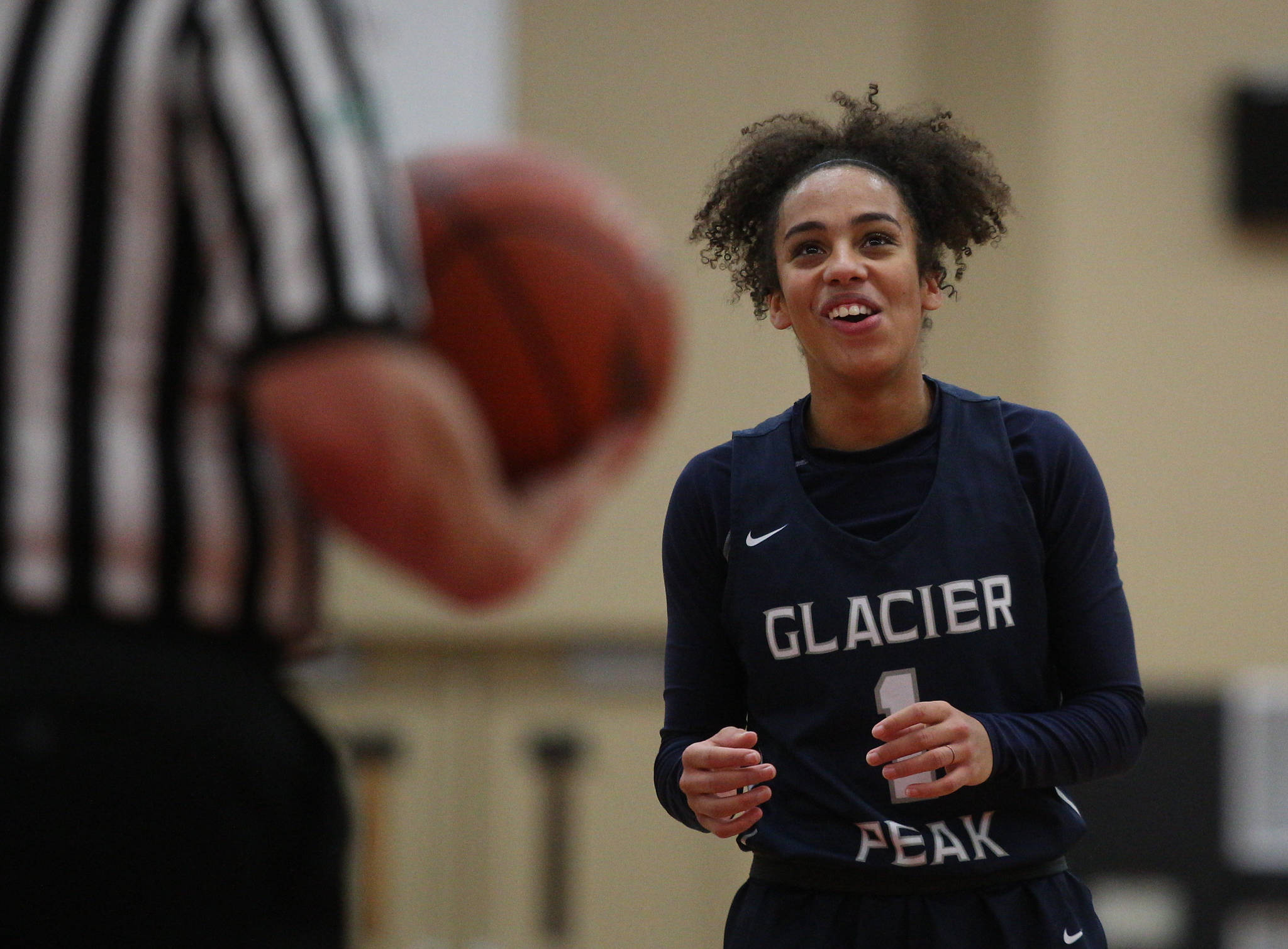 Glacier Peak's Aaliyah Collins laughs while standing at the free-throw line during a game against Snohomish on Dec. 9, 2019 at Snohomish High School. (Andy Bronson / The Herald)