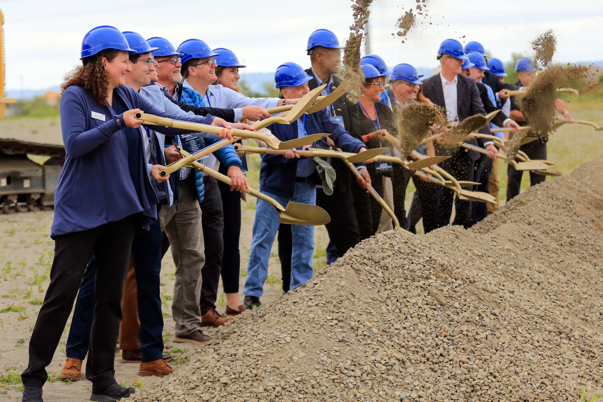 Community leaders and officials break ground at the Port of Everett's Norton Terminal, on the former Kimberly-Clark mill site, Thursday morning in Everett. (Kevin Clark / The Herald)