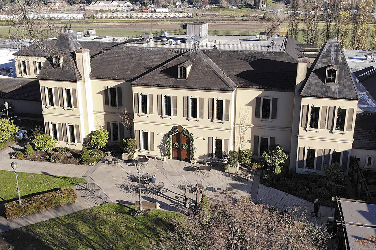 In this photo taken Thursday, Nov. 21, 2019, the French-style inspired main building of the Chateau Ste. Michelle winery is seen in Woodinville, Wash. Washington, which now boasts more than 1,000 wineries in the state, has become a force in the wine industry. Washington is the second-largest producer of premium wines in the United States, trailing only California. (AP Photo/Elaine Thompson)