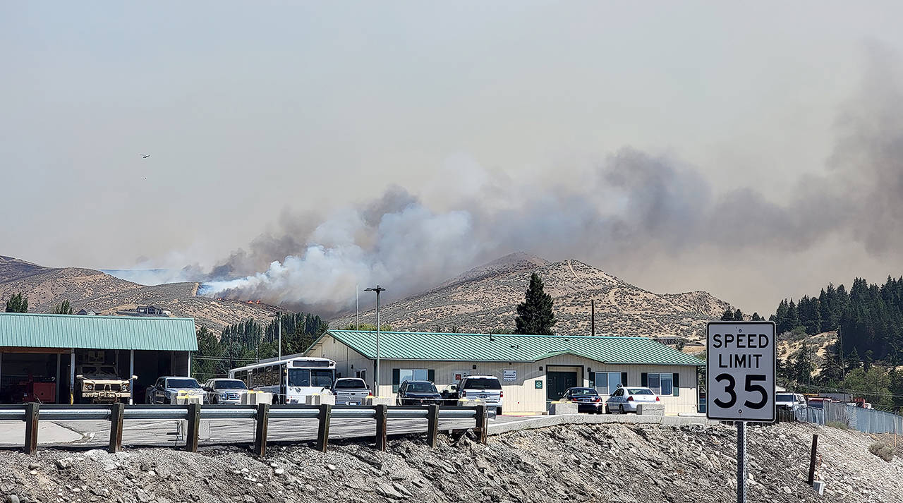 The Red Apple Fire was threatening homes, apple orchards and an electrical substation, but no structures have been lost, officials said. (Washington State Department of Transportation)