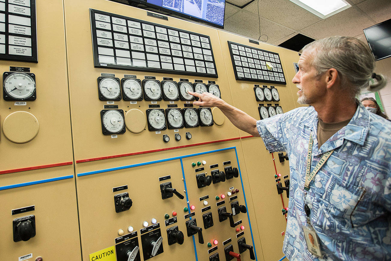 PUD Generation Senior Manager Brad Spangler points out a megawatt meter for one of two generators that provide power to the City of Everett at the Henry M. Jackson Hydroelectric Project on Friday, July 23, 2021 in Sultan, Wash. (Olivia Vanni / The Herald)