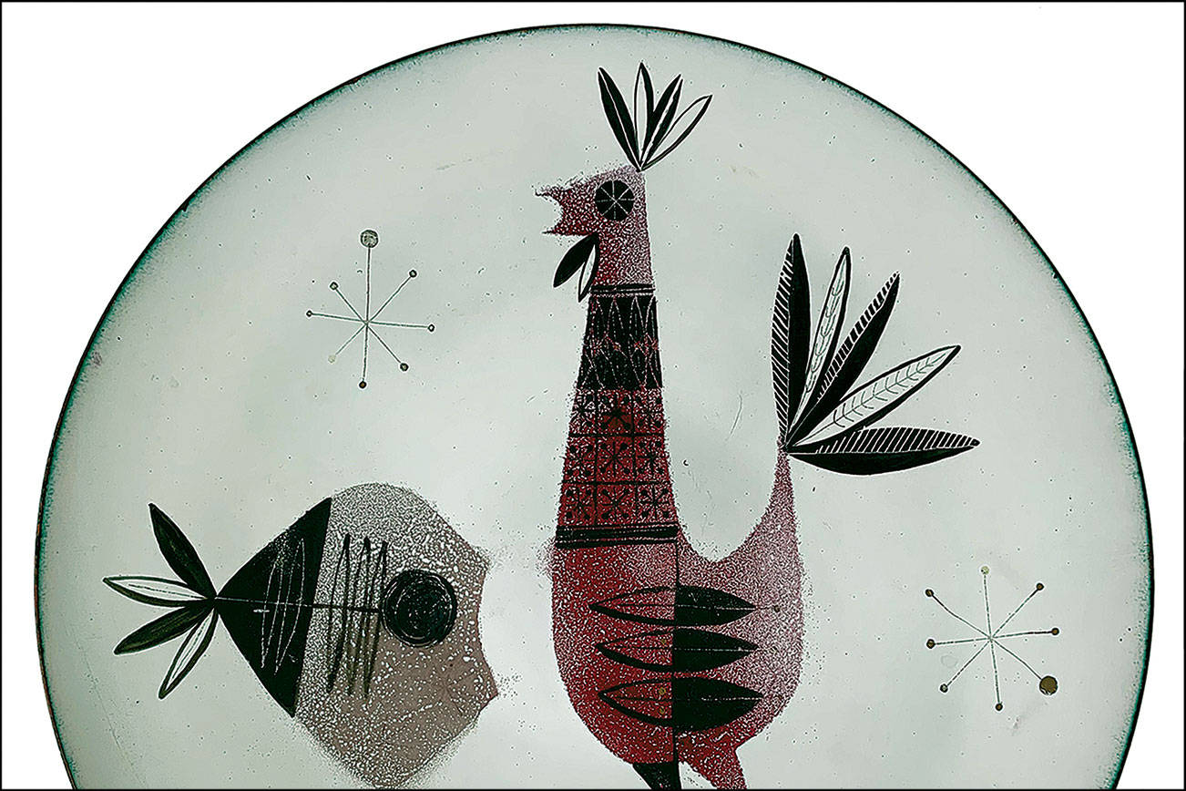"""This large, enameled copper plate is decorated with a stylized rooster, fish and three star-like designs. The back is textured enamel with the mark """"Karamu OH Hykes."""" (Cowles Syndicate Inc.)"""