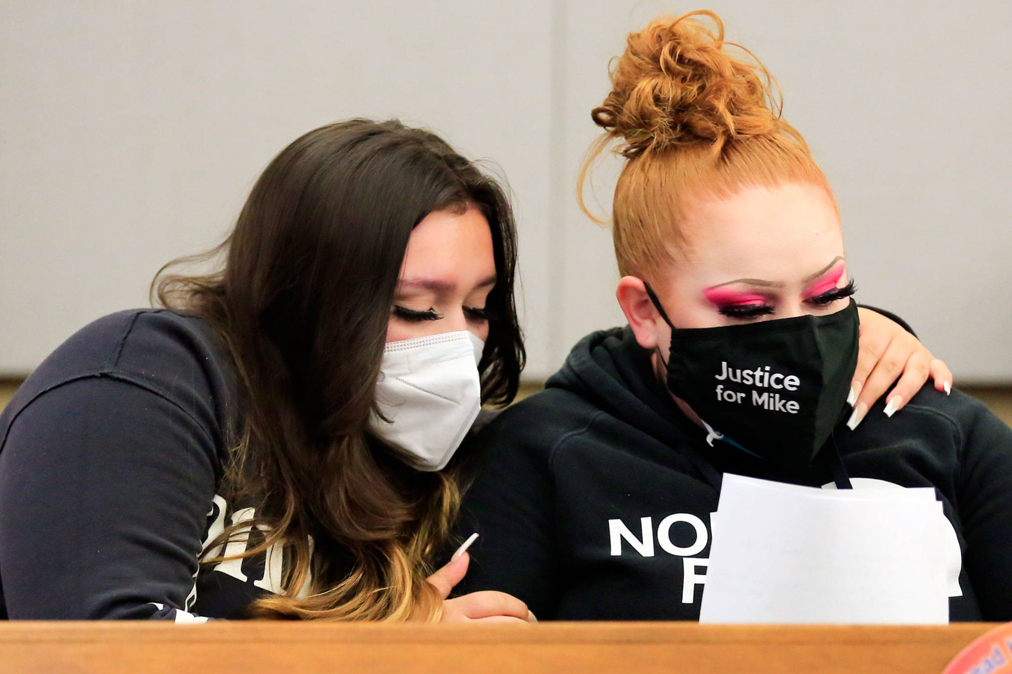 Nevaeh Smith (left), niece of murder victim Michael Smith, and Shuston Smith, Michael Smith's sister, embrace at the sentencing of Jesse Engerseth Tuesday at the Snohomish County Courthouse in Everett. (Kevin Clark / The Herald)