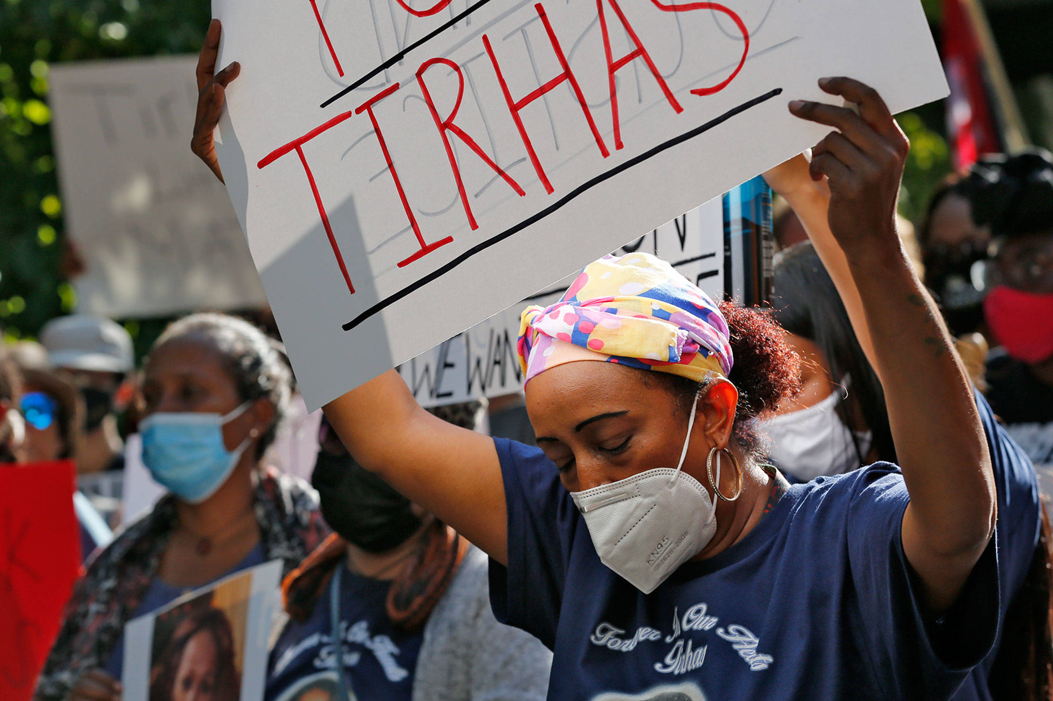 Family members gather Monday at Lynnwood City Hall seeking answers about the death of Tirhas Tesfatsion. (Kevin Clark / The Herald)
