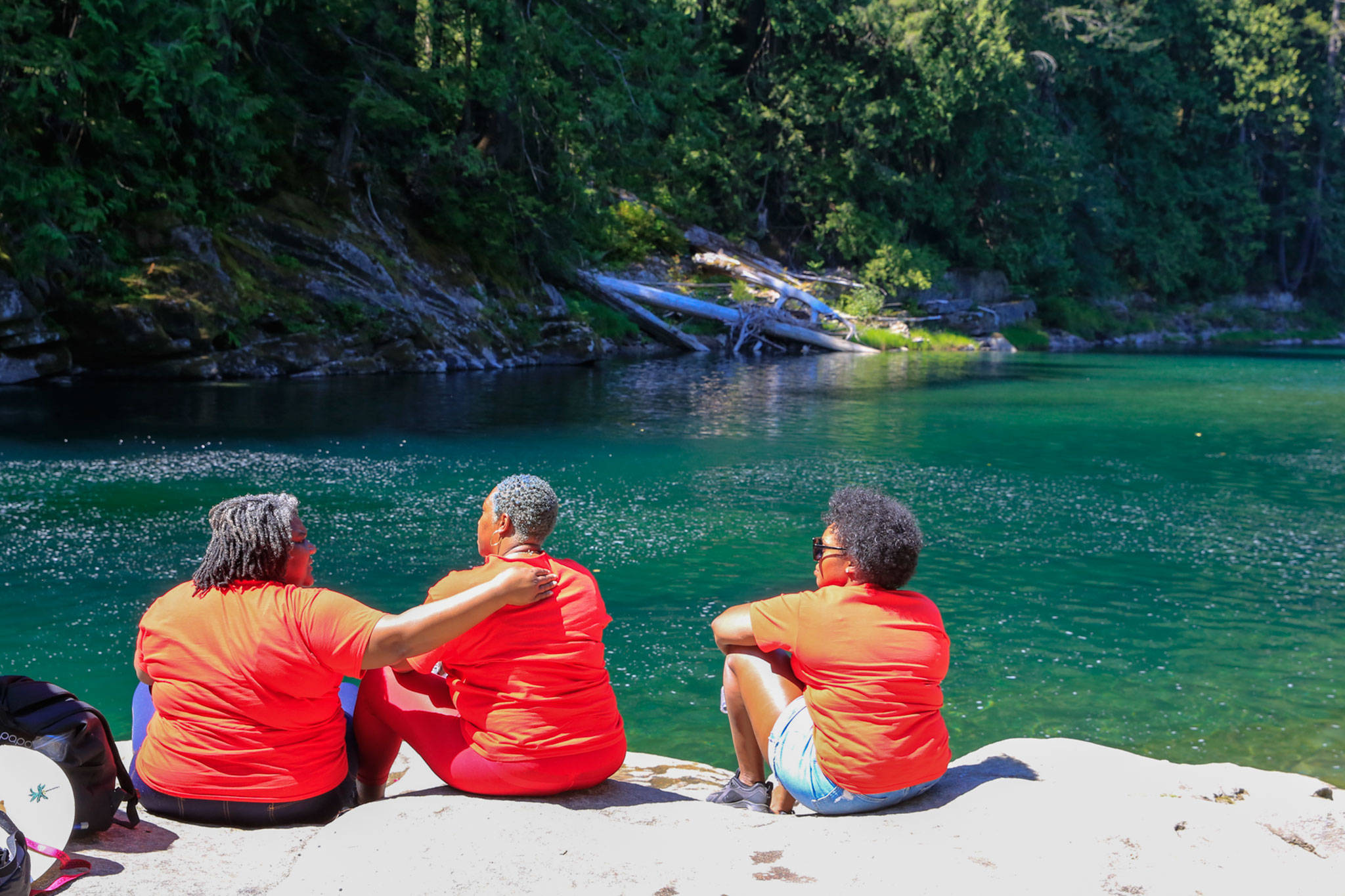 Family and friends gather by the Skykomish River at Eagle Falls in memory of Devin Shelby. (Kevin Clark / The Herald)