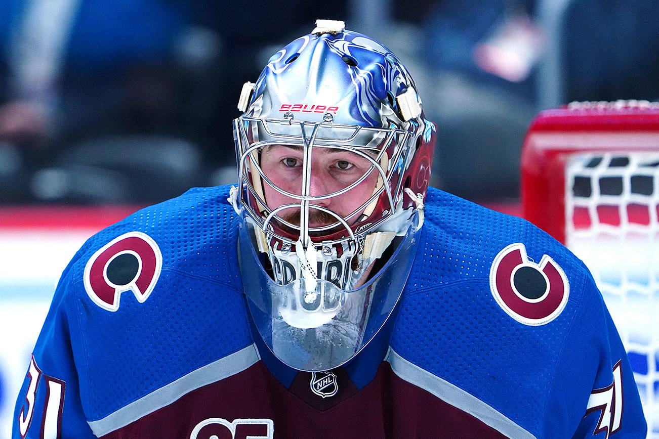 Colorado Avalanche goaltender Philipp Grubauer (31) eyes the puck against the Vegas Golden Knights in the third period of Game 1 of an NHL hockey Stanley Cup second-round playoff series Sunday, May 30, 2021, in Denver. (AP Photo/Jack Dempsey)