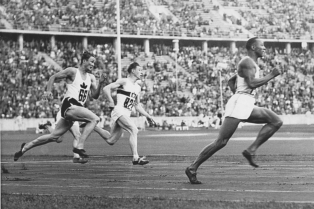 In this photo Jesse Owens leads the race during heat 3 of the 200m quarter final. From the left we see Lee Orr of Canada and Karl Neckermann of Germany. (Photo Courtesy of the Monroe Historical Society)