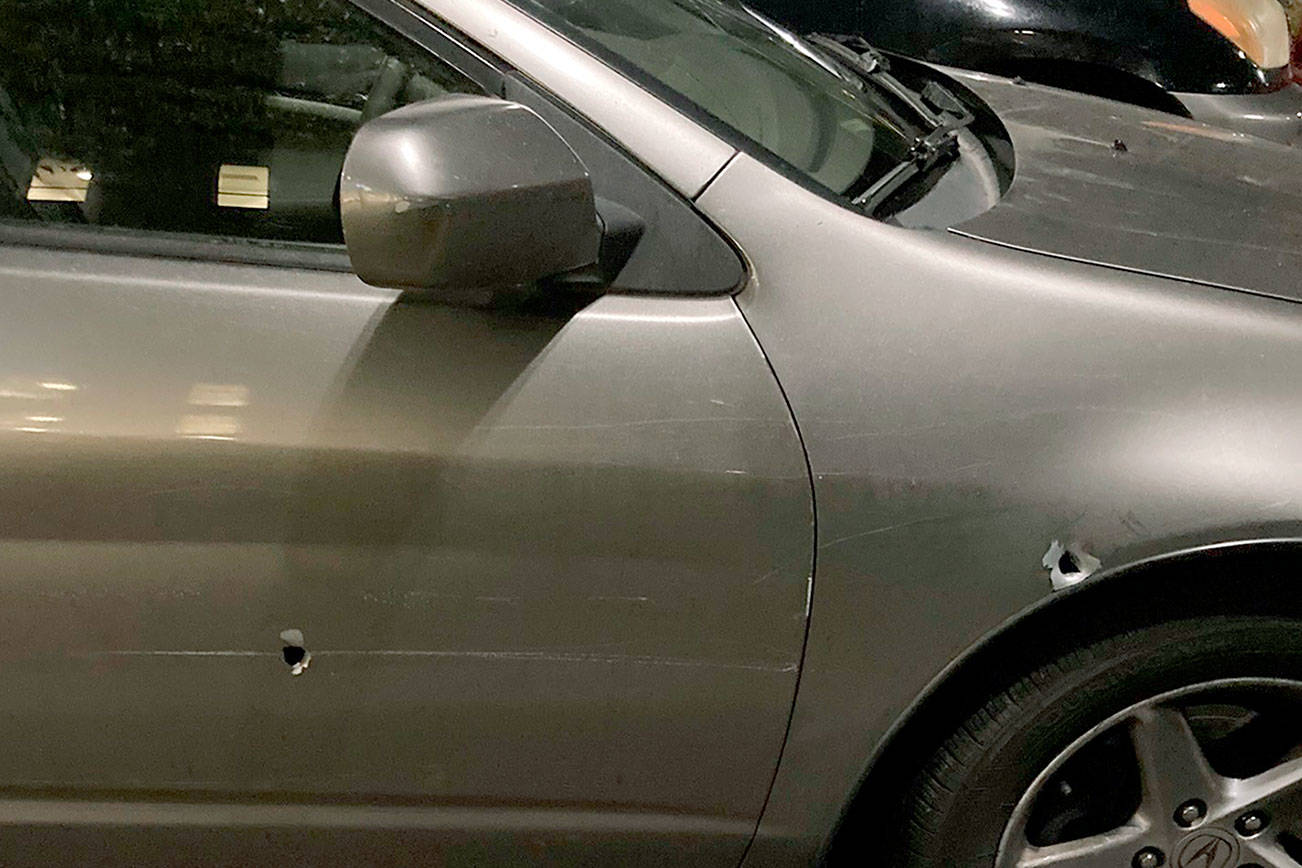 A man was shot Tuesday, Aug. 3, 2021, while driving on I-5 through Lynnwood, according to Washington State Patrol. This is his vehicle, with two bullet holes visible. (Washington State Patrol) 20210804