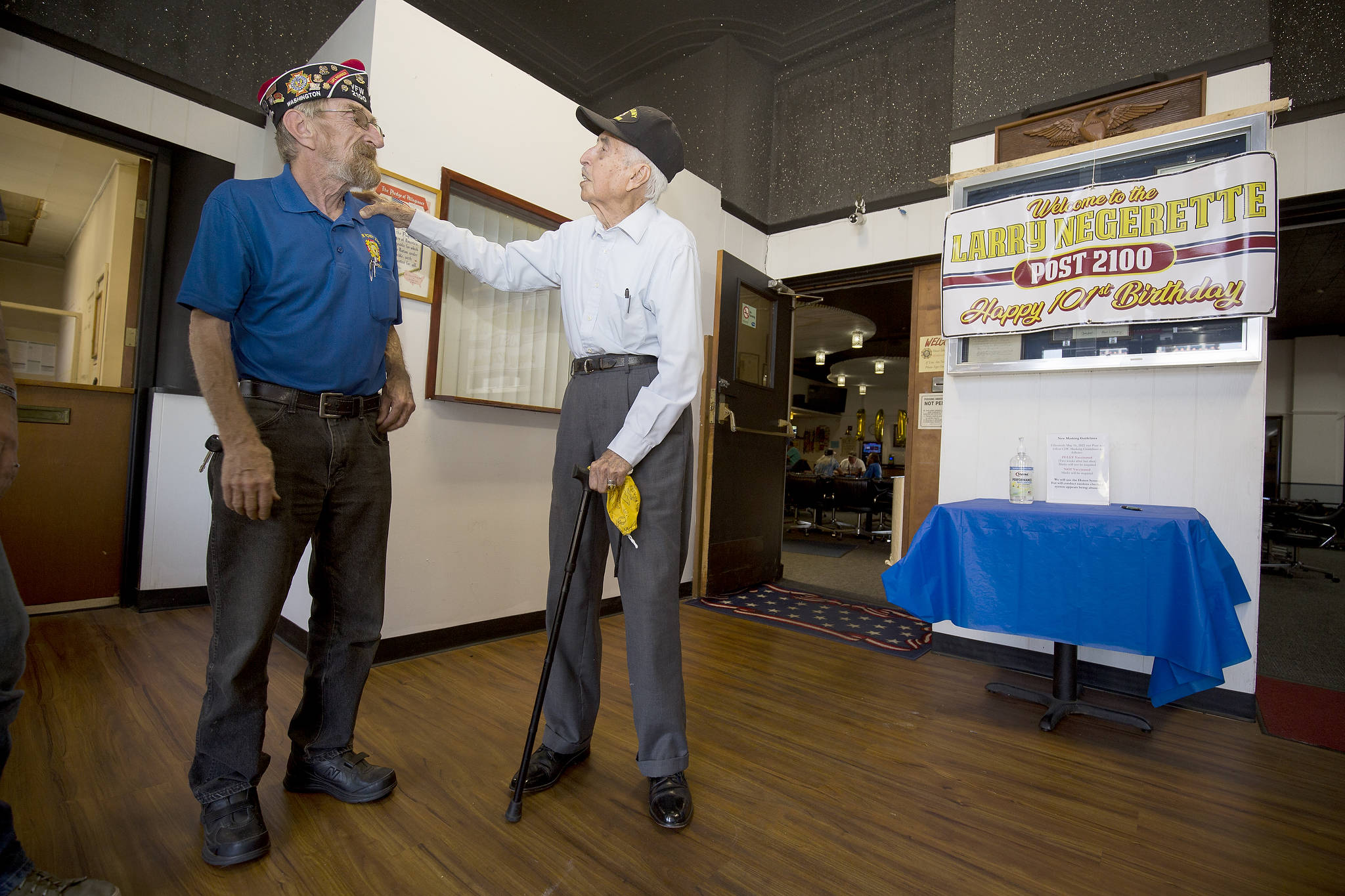 After showing off a few tap-dancing moves, Donald Wischmann (left) gets a little teasing from World War II veteran Larry Negrette, who was celebrating his 101st birthday at the Everett VFW Post on Tuesday. (Andy Bronson / The Herald)