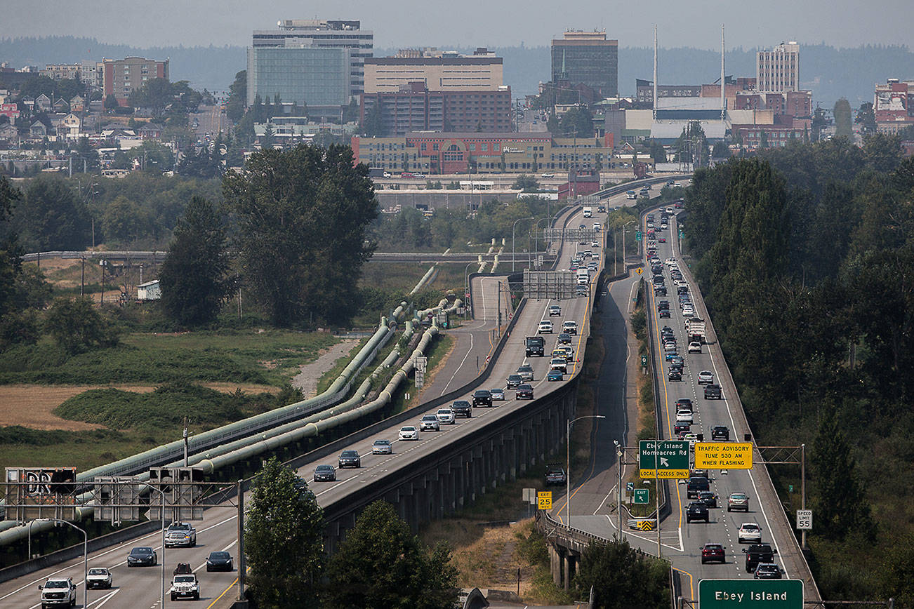 Afternoon traffic moves along the U.S. 2 trestle between Everett and Lake Stevens on Thursday, Aug. 12, 2021 in Everett, Wash. (Olivia Vanni / The Herald)
