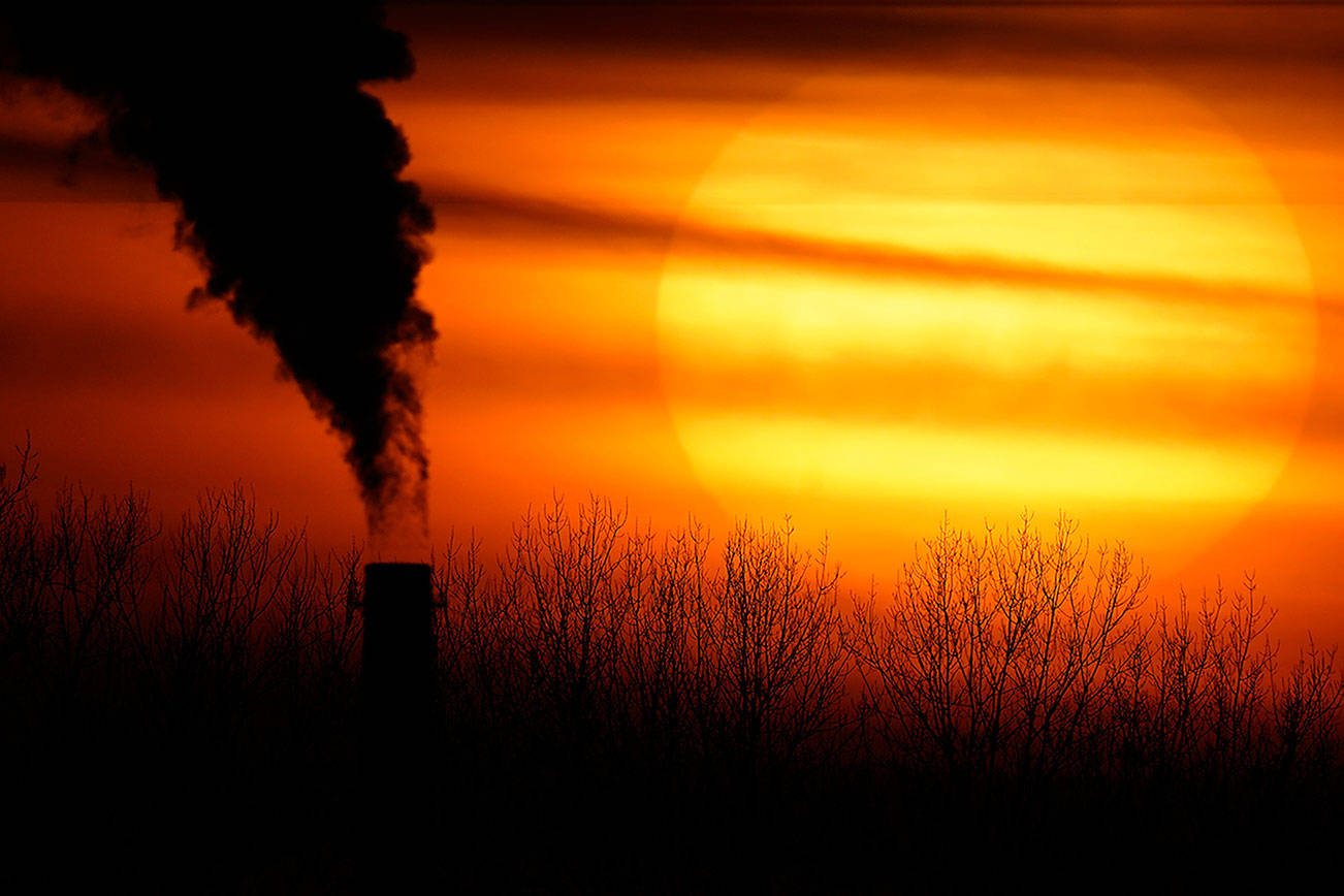 FILE - In this Monday, Feb. 1, 2021 file photo, emissions from a coal-fired power plant are silhouetted against the setting sun in Independence, Mo. A United Nations report released on Thursday, Feb. 18, 2021 says humans are making Earth a broken and increasingly unlivable planet through climate change, biodiversity loss and pollution. So the world must make dramatic changes to society, economics and daily life. (AP Photo/Charlie Riedel)