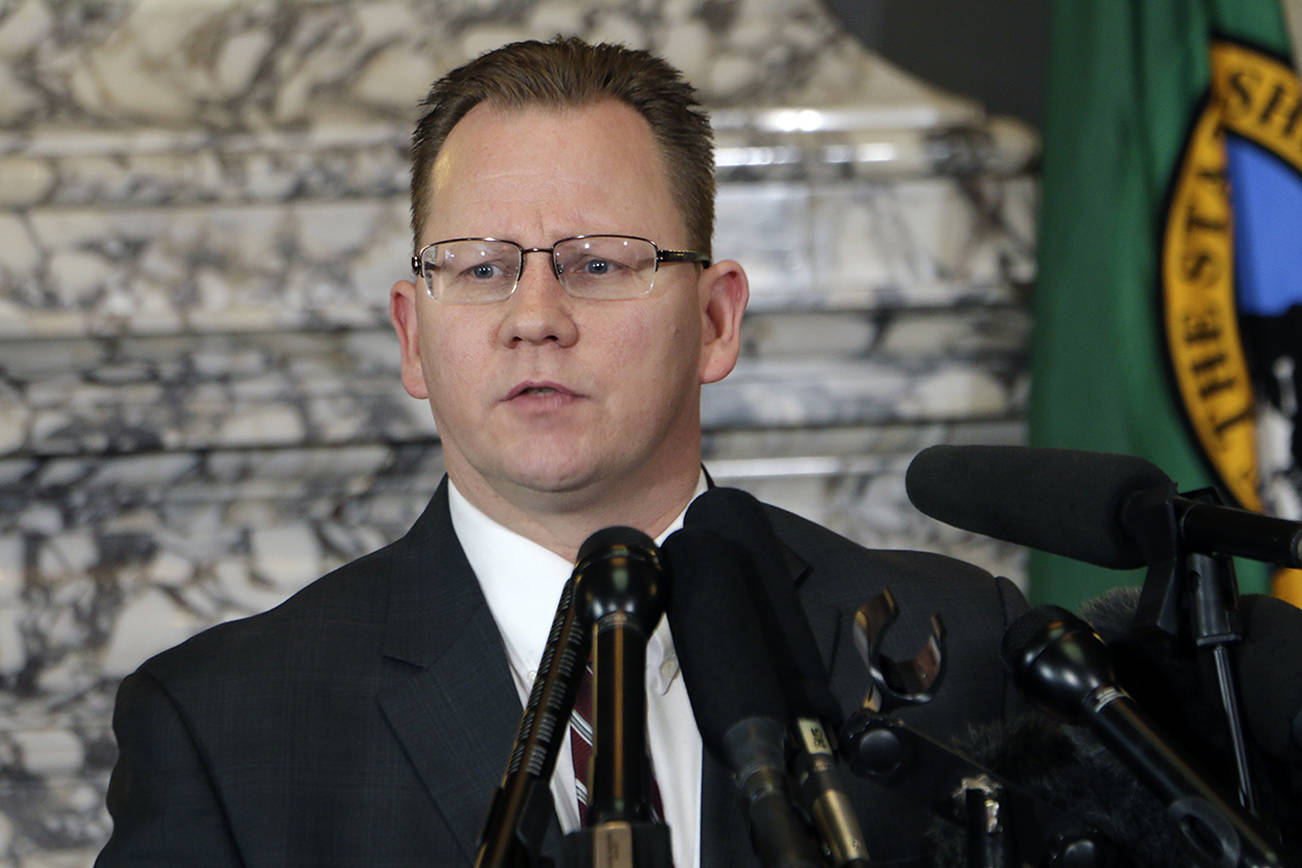 State Superintendent of Public Instruction Chris Reykdal talks to the media about the decision to close schools in three counties in response to COVID-19, Thursday, March 12, 2020, in Olympia, Wash. All public and private K-12 schools in King, Pierce and Snohomish counties will be closed for six weeks, and Gov. Jay Inslee said there could be closures in more counties soon. (AP Photo/Rachel La Corte)