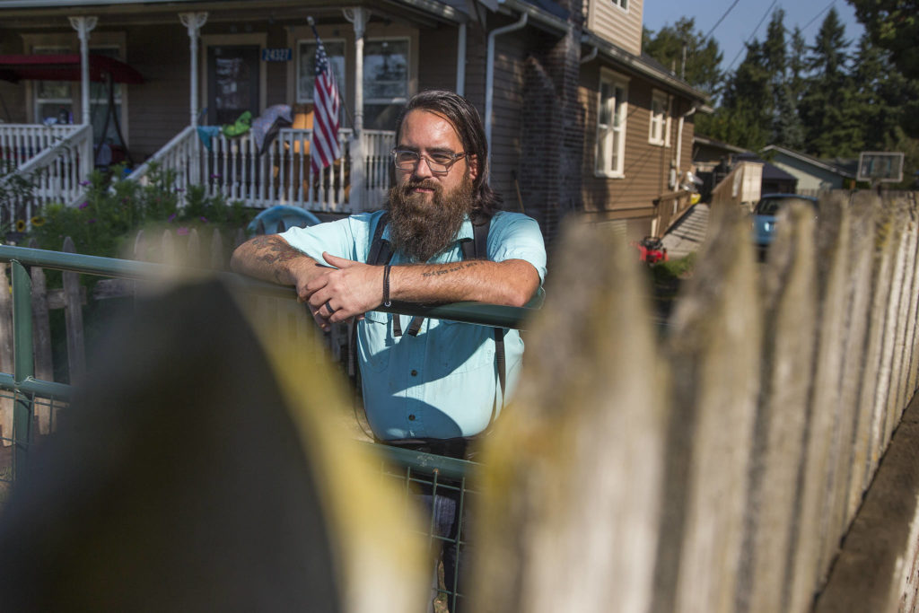 Jasan Winship, a data administrator with Volunteers of America, talks about his life after a couple of accidents that led to him feeling like a burden to his family, Tuesday in Sedro-Woolley. (Andy Bronson / The Herald)