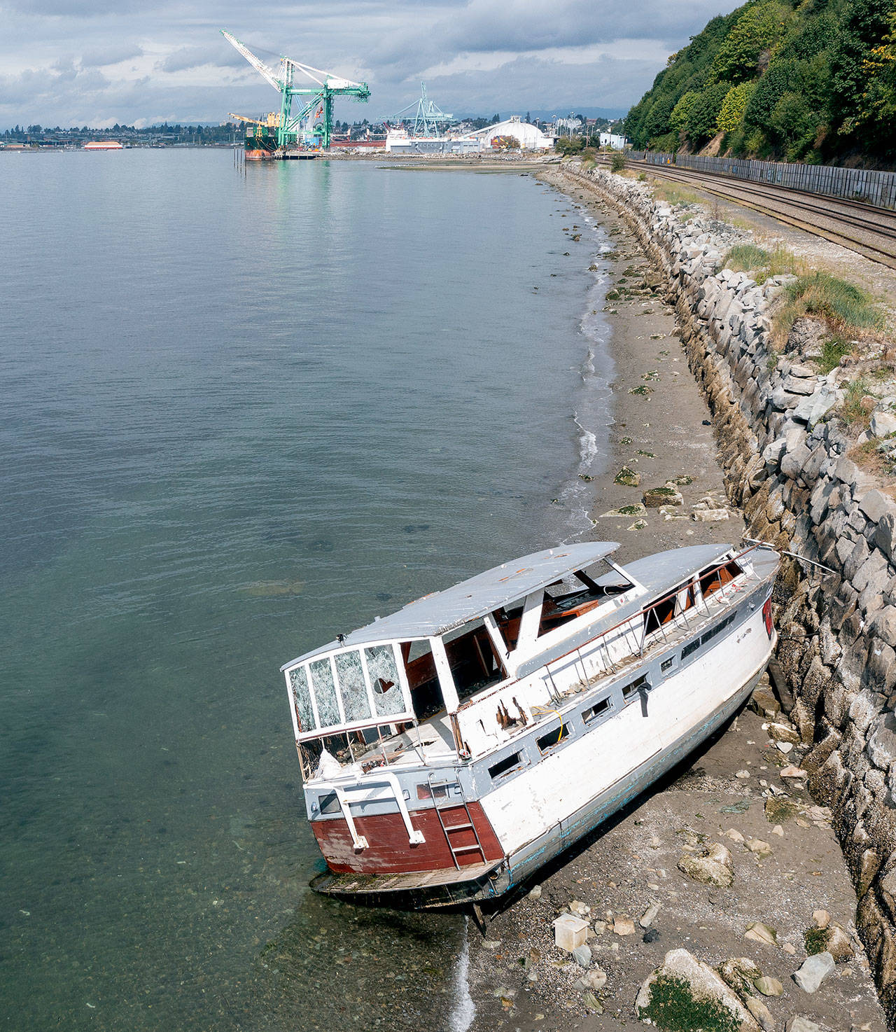 A derelict boat near Howarth Park in Everett, along the railroad breakwater south of the Port of Everett. (Chuck Taylor / The Herald)