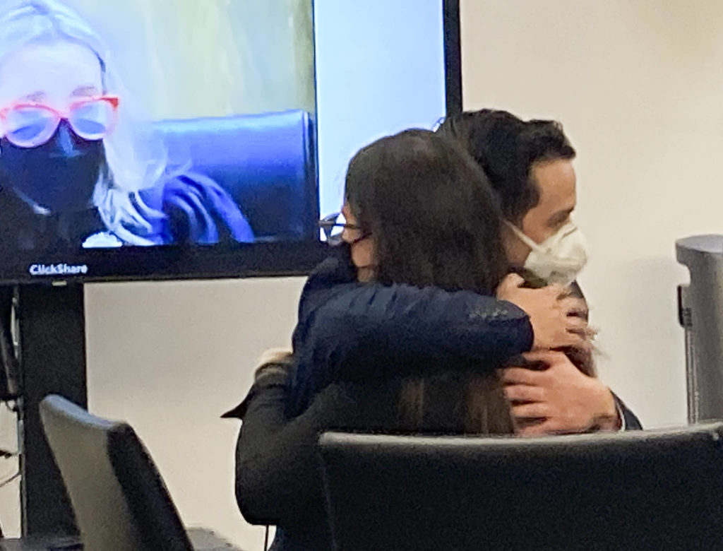 Anthony Zayas hugs defense attorney Samantha Sommerman after a jury acquitted the former sheriff's deputy of third-degree child rape on Monday in Everett. (Herald staff)