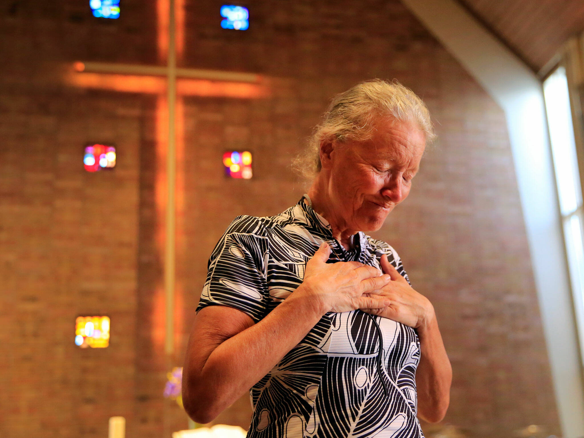Lynn Salvo reacts to receiving her brother's wedding ring Tuesday at the Everett United Church of Christ. Her brother died in Vietnam. (Kevin Clark / The Herald)