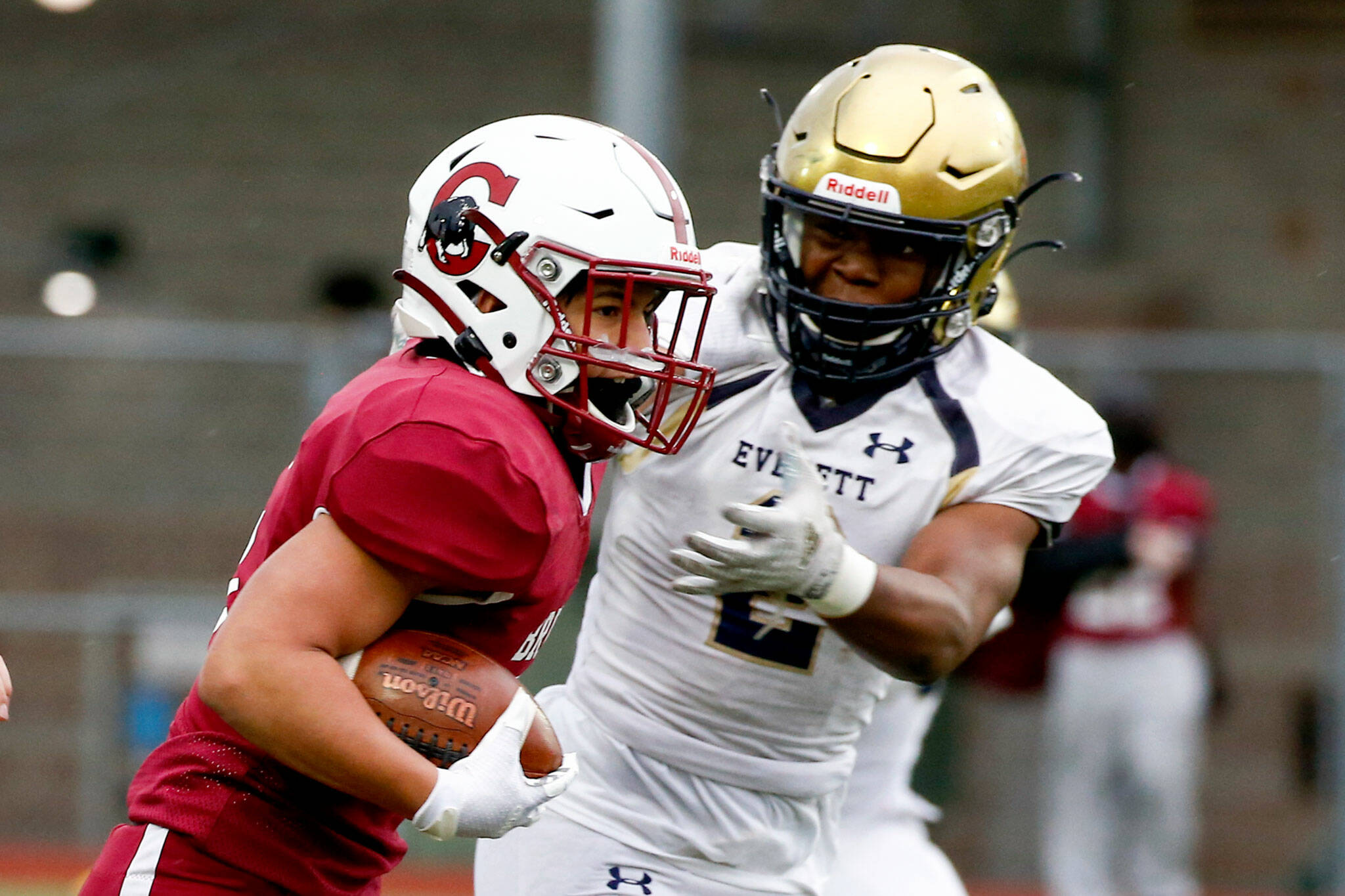 The annual Battle of Broadway between Everett High and Cascade High at Everett Memorial Stadium Friday night on March 19, 2021. (Kevin Clark / The Herald)