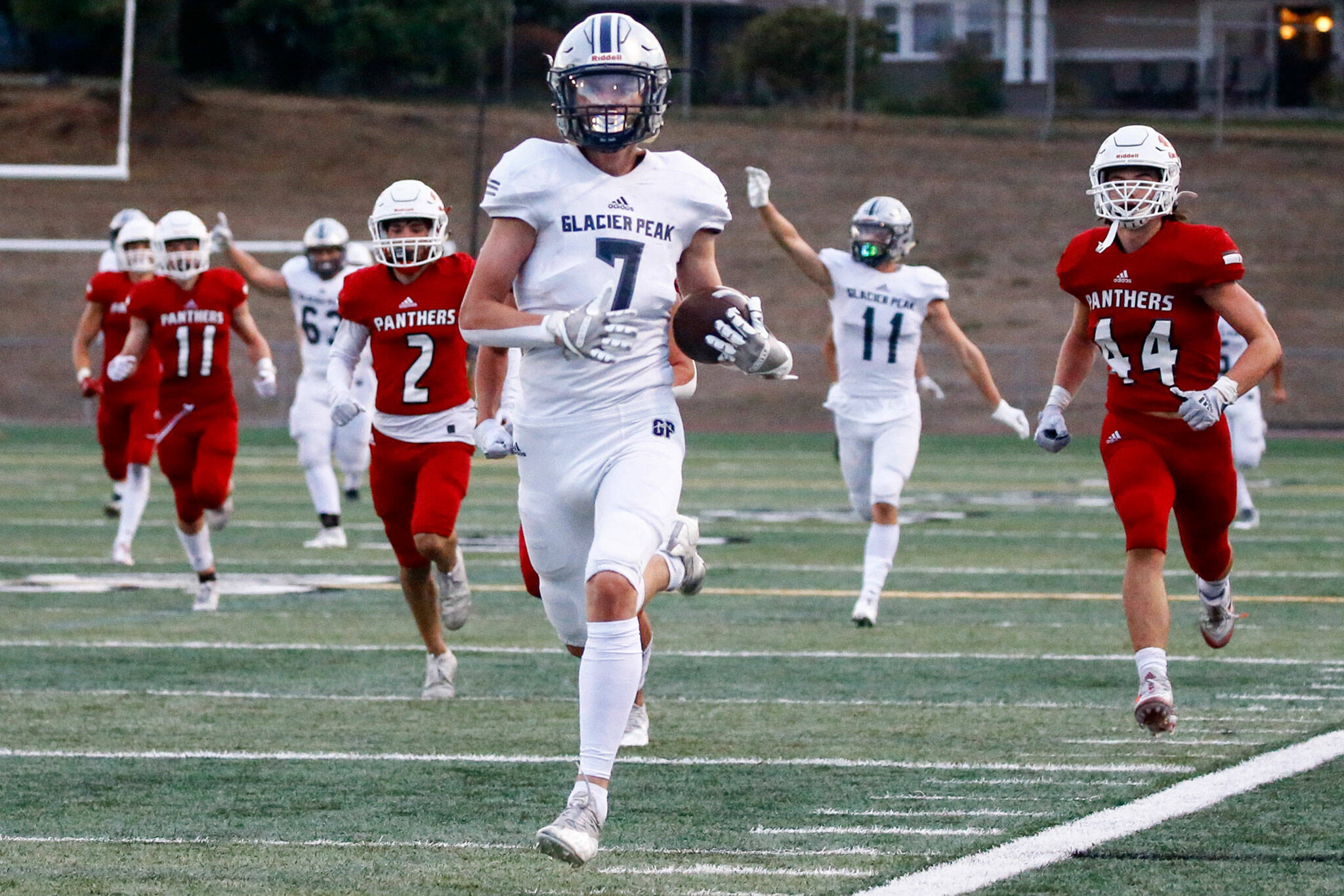 Glacier Peak's Logan Szarzec outruns the Snohomish defense for a touchdown during the second quarter Friday night at Veteran's Memorial Stadium in Snohomish. (Kevin Clark / The Herald)