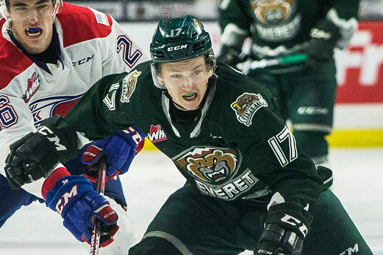 Silvertips' Jackson Berezowski beats Spokane's Jack Finley to the puck during the game against the Spokane Chiefs on Nov. 17, 2019 in Everett, Wash. (Olivia Vanni / The Herald)