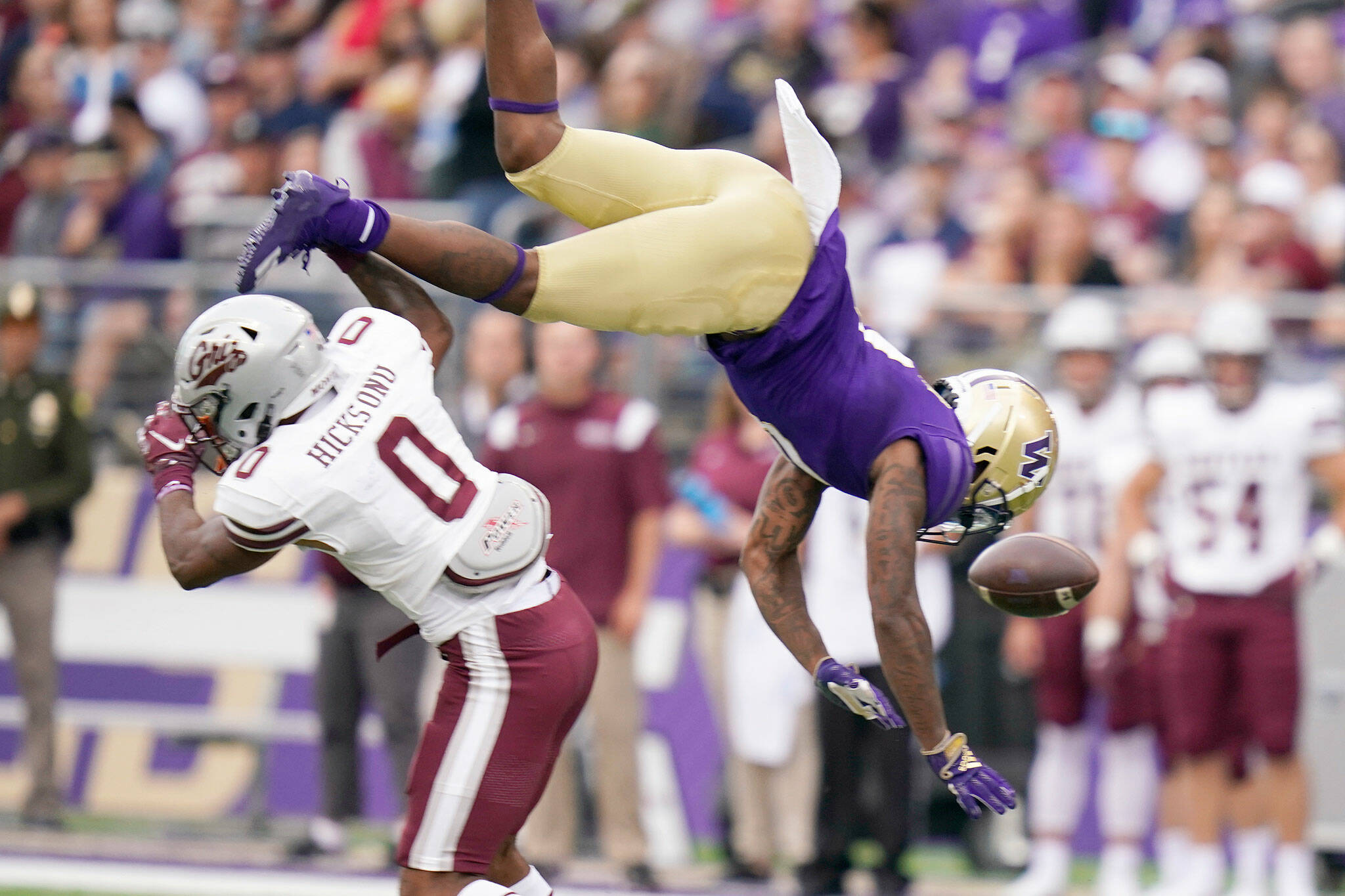 Montana's Omar Hicks Onu (left) upends and breaks up a pass intended for Washington's Giles Jackson during the first half of a game Saturday in Seattle. (AP Photo/Elaine Thompson)