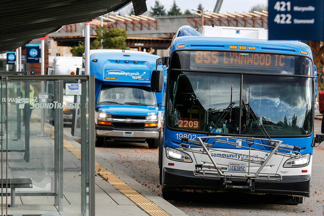 Community Transit is preparing to shift commuter buses that go to the University of Washington in Seattle to connect with Link light rail in Northgate next year. (Kevin Clark / The Herald)
